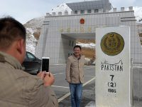 In this photograph taken on September 29, 2015, a Chinese national takes a photograph( Courtesy: Dawn)