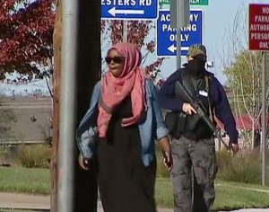 Armed member of anti islamic group BAIR following an American Muslim women (Source Fox News)