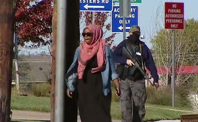 Armed member of anti islamic group BAIR following an American Muslim women (Source Fox News)