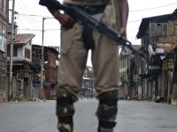 Indian paramilitary soldiers stand guard during curfew in Srinagar, Indian controlled Kashmir, Friday, July 15, 2016. Curfew imposed in the disputed Himalayan region continued for the seventh straight day to check anti-India violence following the recent killing of Burhan Wani, chief of operations of Hizbul Mujahideen, Kashmir's largest rebel group. (AP Photo/Dar Yasin)